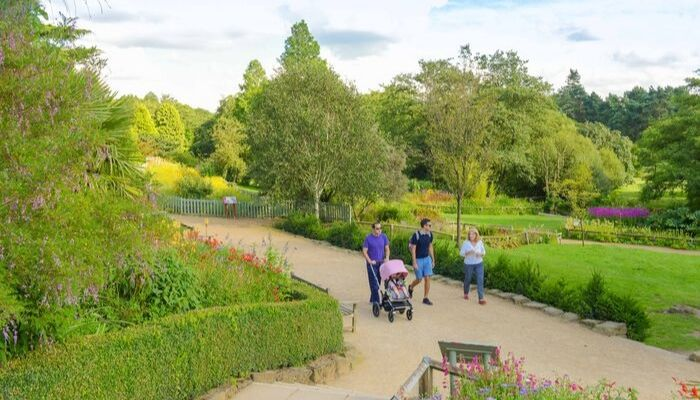 A family enjoying Golden Acre Park, Adel